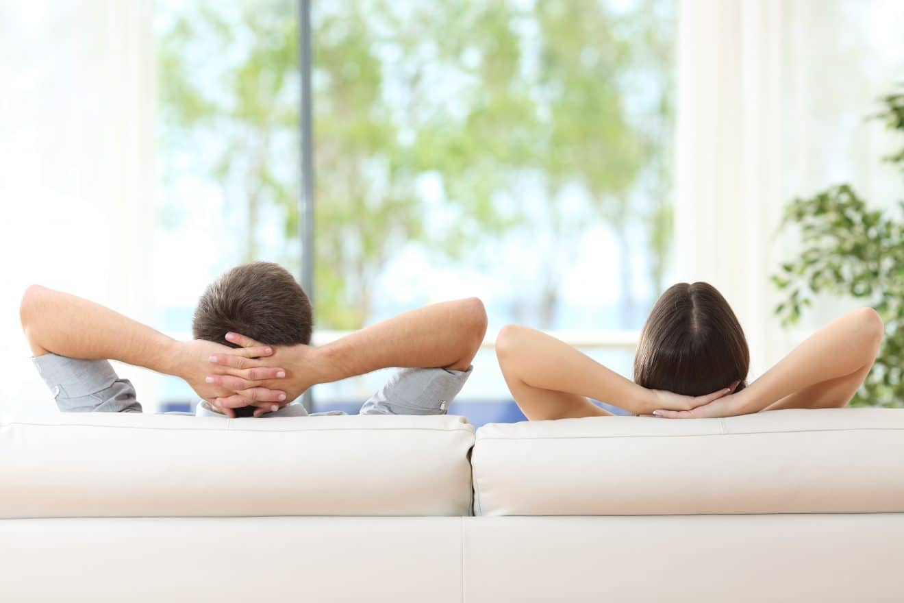 Couple relaxing on a couch at home